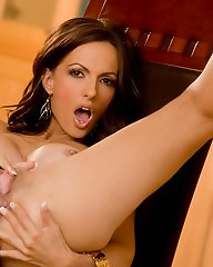 Catalina Cruz spreads her legs over a chair