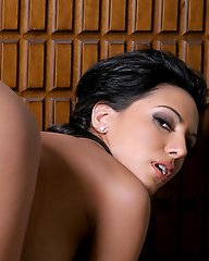 Lela Star bends over and inserts a dildo