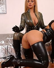 Latex Domina with blonde slave